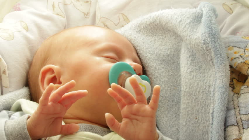 Closeup little newborn baby girl 24 days sleeping. Full HD 1920X1080P | Shutterstock HD Video #9944171