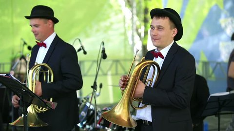 """MOSCOW, RUSSIA - MAY 09, 2015: Two cornet in the orchestra. Brass Band performing on the stage in the park. Festival marching bands in the city park """"Muzeon."""""""